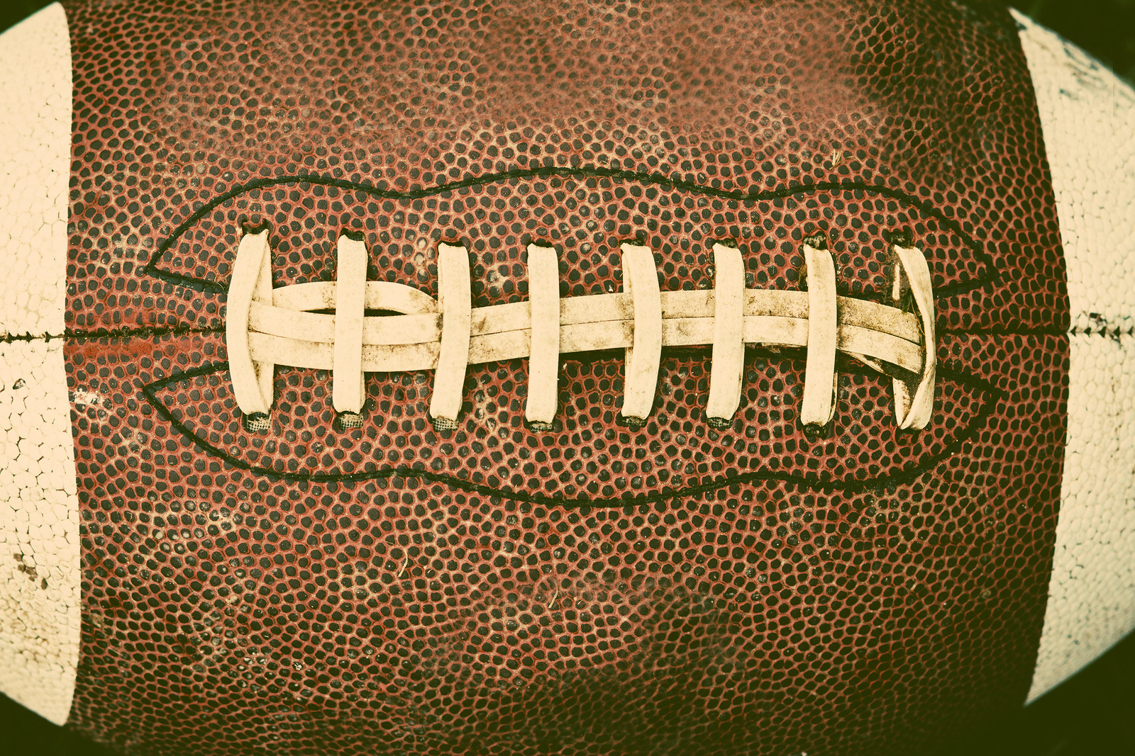 Close up of dirty football