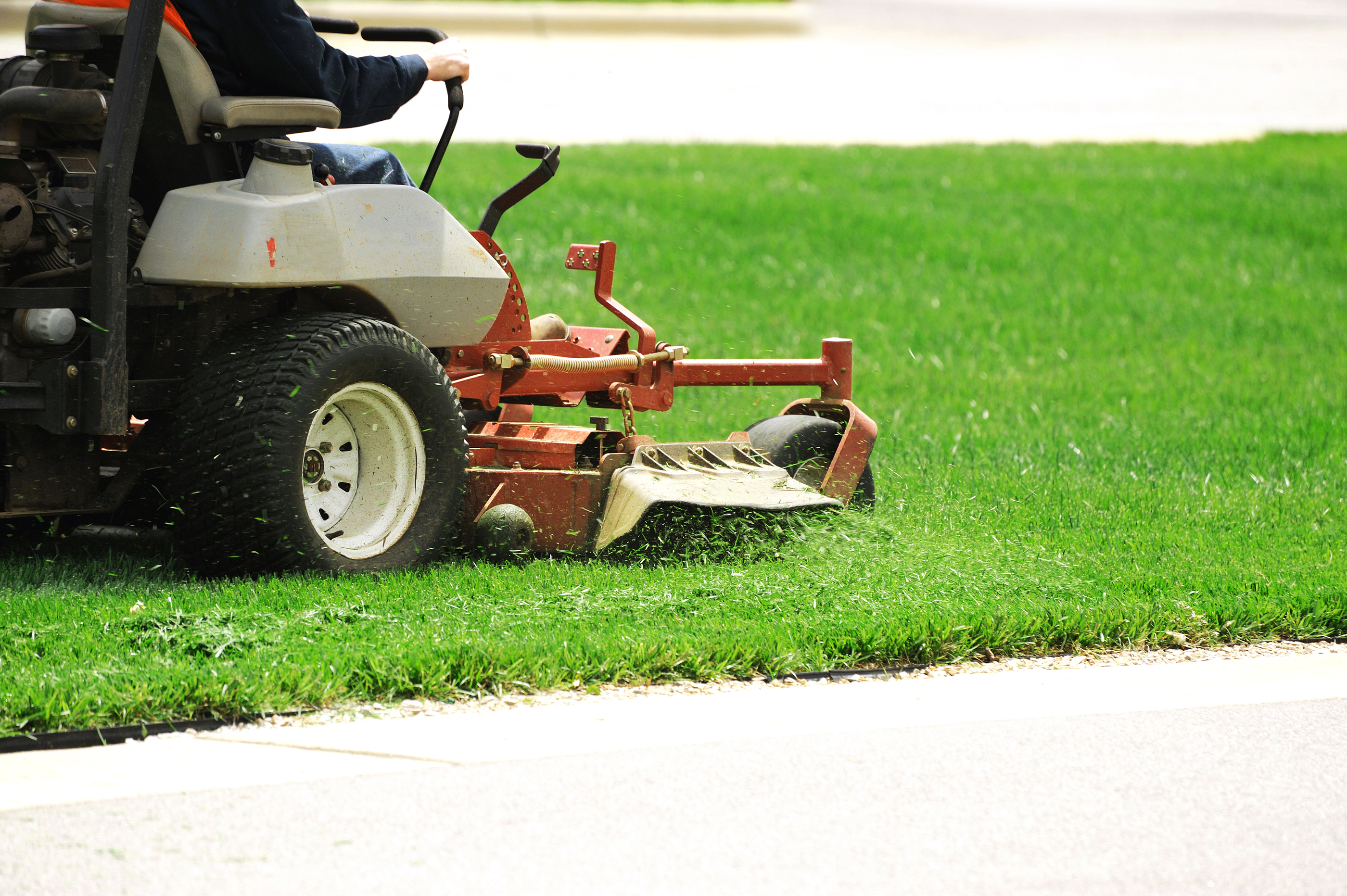 Riding Lawnmower mowing grass