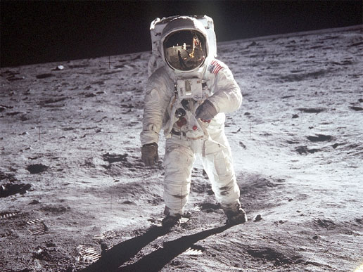 Apollo 11 astronaut Buzz Aldrin walks on the surface of the moon near the leg of the lunar module Eagle